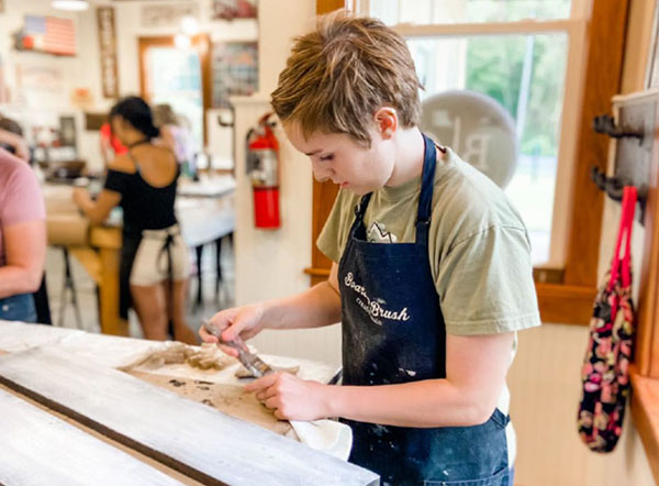 Teen at Paint Workshop